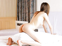 Heavenly hot chick is having fun alone with a pillow on the bed totally naked