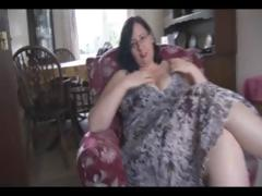 Fat mature brunette with huge tits and ass sticks dildo in her pussy