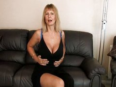 Mature mom at home rubbing her pussy