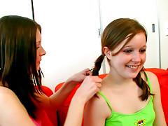 Lesbian teens have fun using dildo