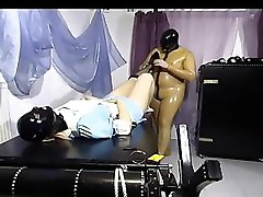 Delicious slave chick in latex mask getting fucked really hard on bed