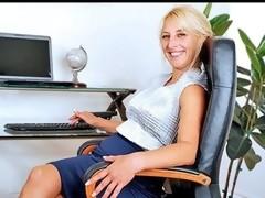 Lovely older secretary masturbates in her bosses office chair
