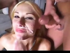 Cutie gagging on two hard cocks